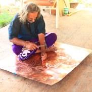 Sooriya working on copper art